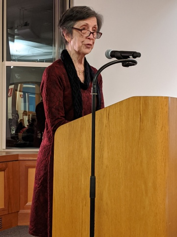 Moira Linehan: Image description - A woman standing at a podium.